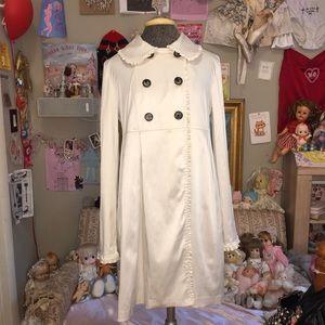 White jacket with ruffles at seams
